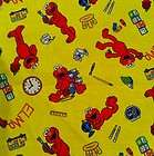 AN ADORABLE ELMO LEARNING YELLOW TOSSED COTTON FABRIC BY THE YARD