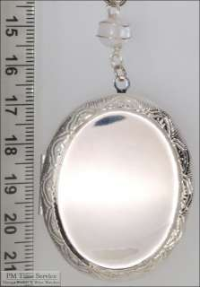 WBM large oval locket, engraved, clear glass bead